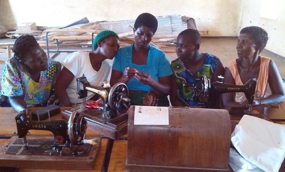 The ladies at Katitima learning how to sew and make the kits.