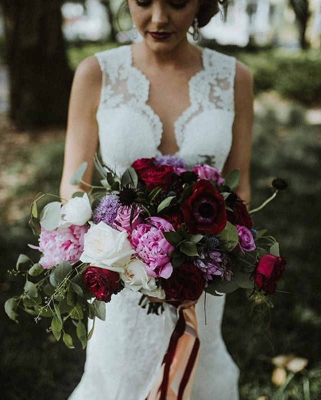 #BelovedVendor @ivoryandbeau is giving us all the moody vibes with the stunning #bridalbouquet! Find the reset of this edgy #savannahwedding captured by @meghanmelia on the journal. Link in profile!  Wedding Vendors: Photography @meghanmelia  Coordinatation/Florals @ivoryandbeau  Catering @jthomascatering Favors @savcandy  Rentals @amazingeventrentals Desserts @lulucakes_savannah & @wickedcakesofsavannah  Hair/Makeup @beyondbeautifulbyheather