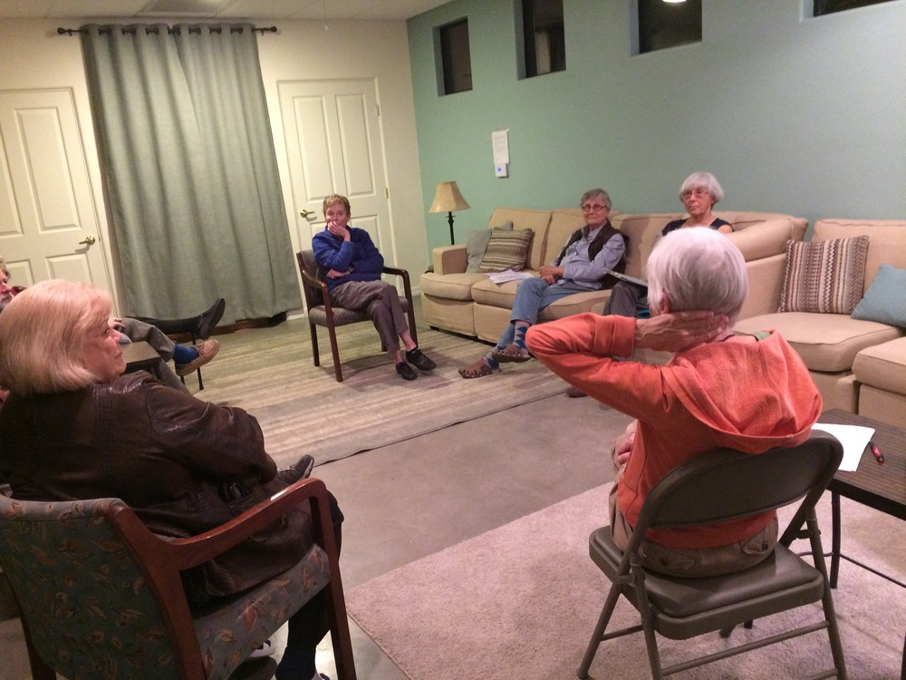 Team meeting in Common House living room.
