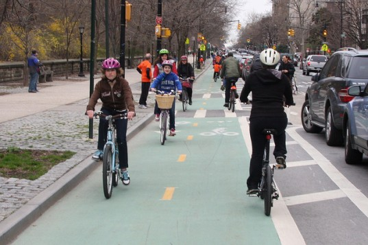 Bicyclists on the Prospect Park West bike lane. From Inhabitat.