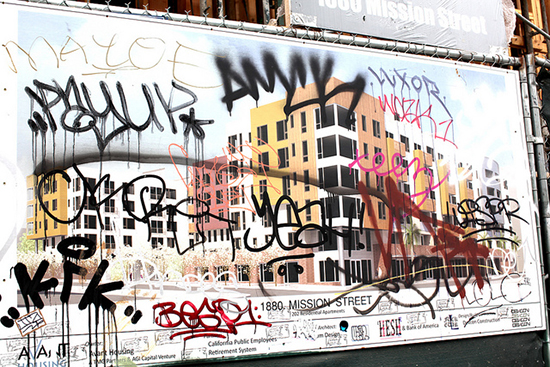Graffiti on a development rendering in San Francisco's Mission District. Photo by Flickr user Torbakhopper.