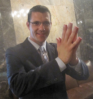 Joe Fain giving himself a high-five after stealing money from the Seattle region to fund wasteful highway projects in rural and suburban Washington.