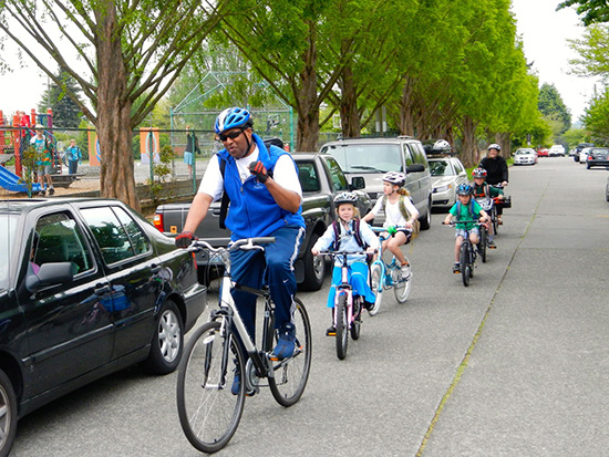 Loyal Heights Elementary principal Wayne Floyd leading a bike train, photo by Clint Loper.