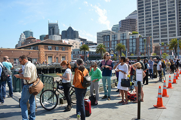 Ferry passengers waiting in line on second day of BART strike, photo by  Steve Rhodes .