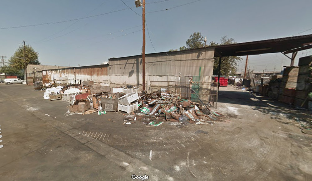 If Measure S passes, it would indefinitely stop the redevelopment of this literal trash heap at 2117 E Violet St into 509 new apartments, including 76 units affordable to low-income households. Image source: Google Maps.