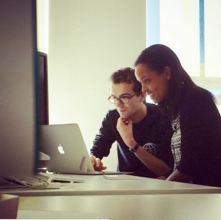 Zach (Engineering) takes the time to teach Maya (Marketing) a new technical skill