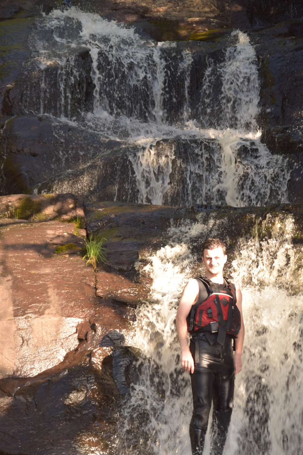 Eric Plant sexily standing beneath a waterfall