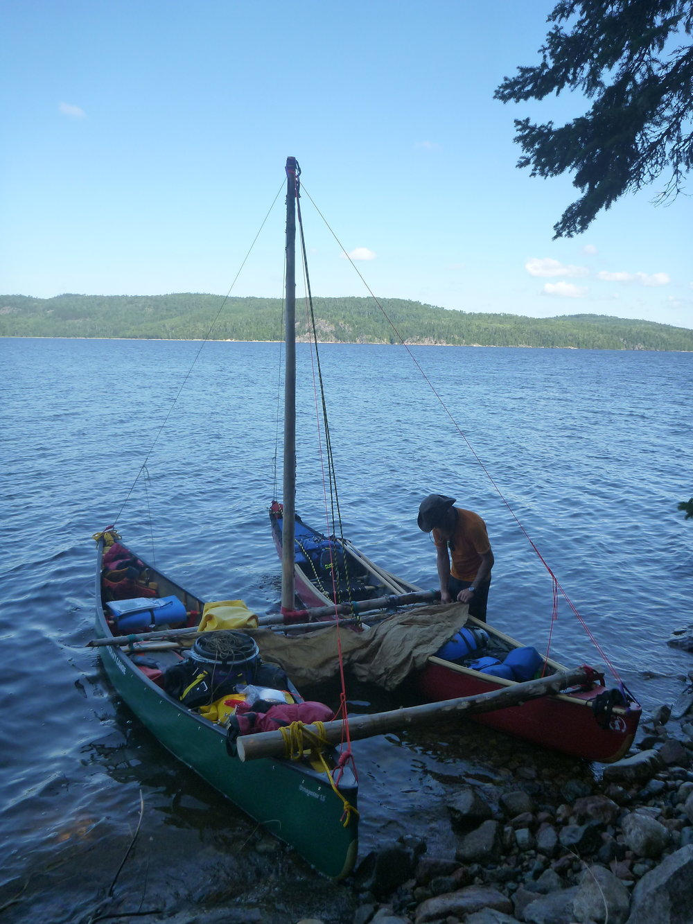 Yup! He's making a catamaran out of two canoes