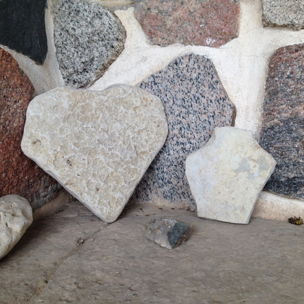 """I heart Wisconsin"" as written with rocks and stone siding my Dad split by hand.."