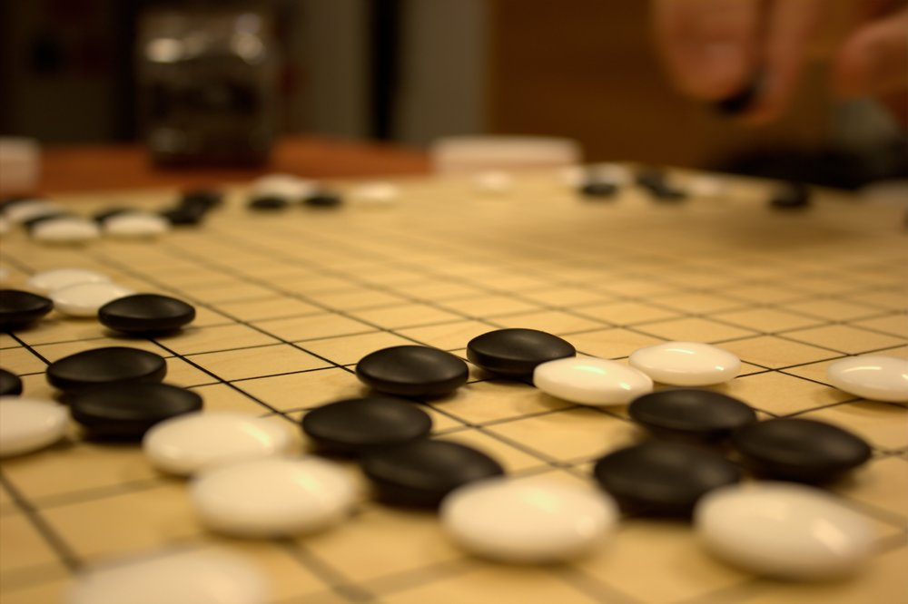 """Game of Go"" by Jaro Larnos is licensed under CC by 2.0."