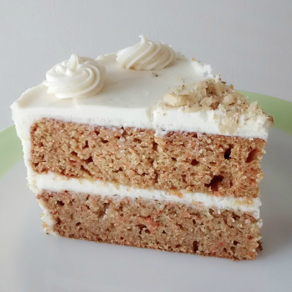 Carrot   Carrot cake layers, cream cheese frosting, and garnished with chopped walnuts.