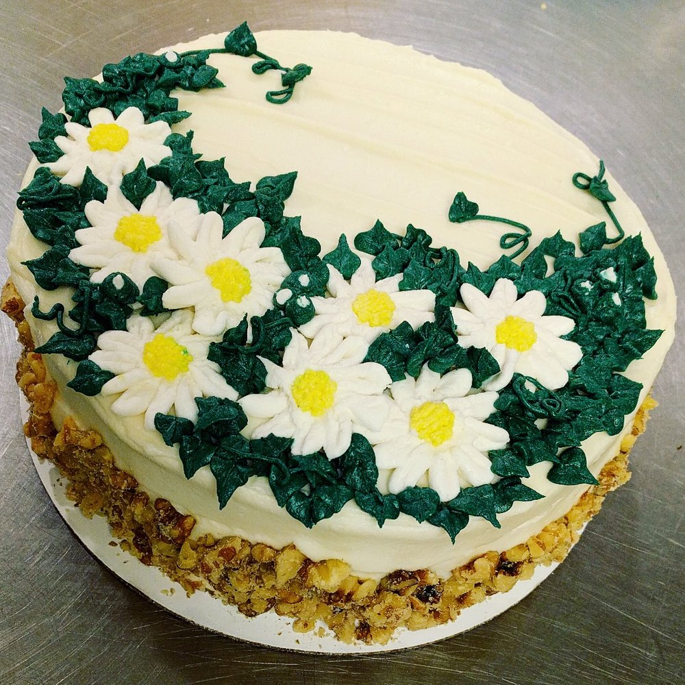 Buttercream Daisies on Carrot Cake