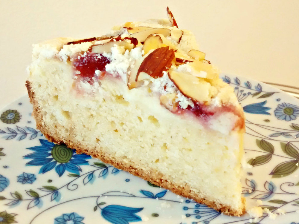 "Raspberry Cream Cheese How we do coffee cake. Rich cake, cream cheese, raspberry jam, and sliced almonds. Available in 9"" only, $22"