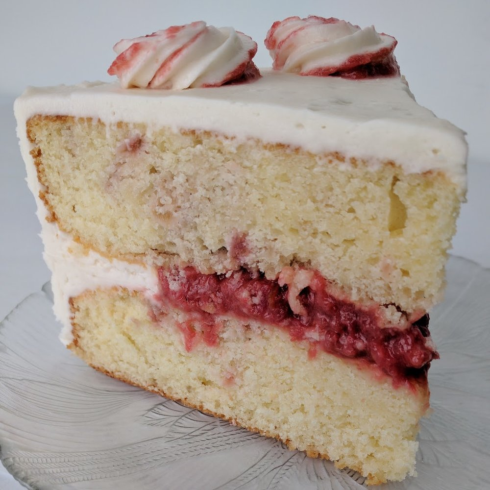 Strawberry Rhubarb    White layers swirled with strawberry rhubarb compote, strawberry rhubarb filling, and vanilla frosting.