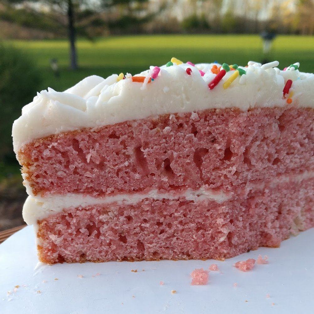 Strawberry Strawberry layers and vanilla frosting.