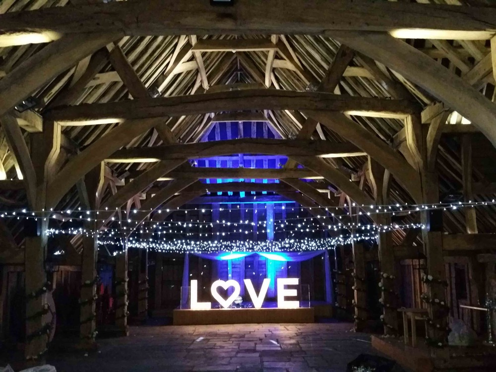 Architectural uplighting and giant LOVE lettering at The Priory Barn