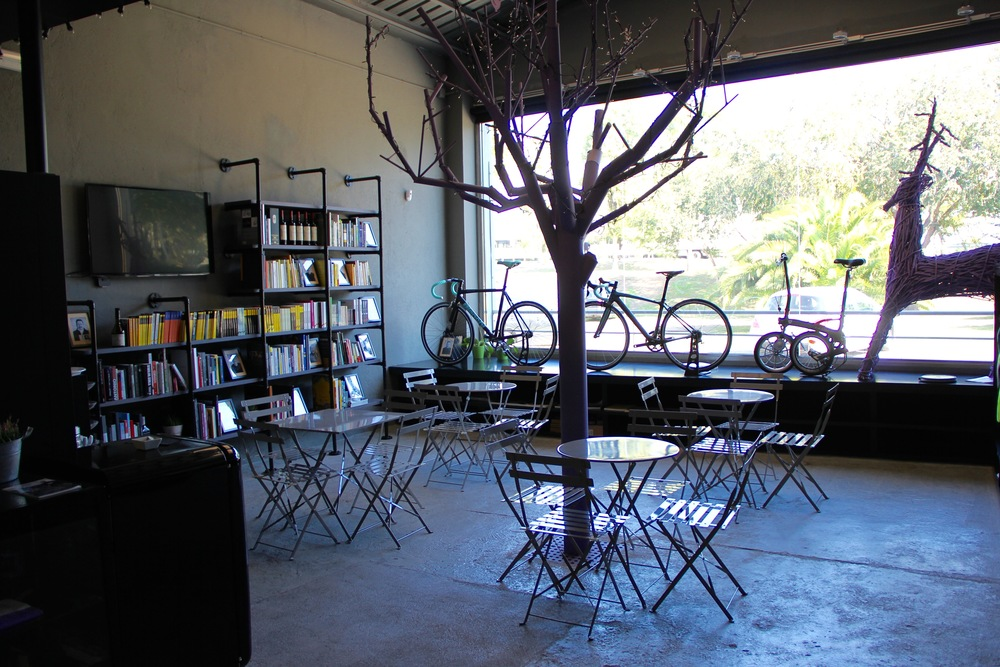 The shop includes a cafe and library for club members to relax in after their morning ride