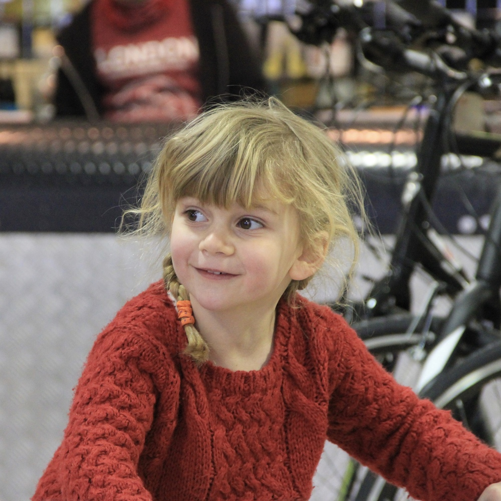 Lewin Chalkley's daughter rides around the spacious new Brixton Cycles shop