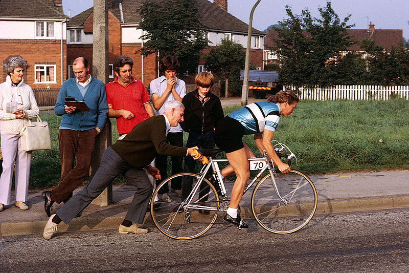 The start of another time trial for multiple British champion Beryl Burton - somewhere in North Yorkshire. A typically low key and casual arrangement for the starter and pusher-off ... Starting No. 70 Beryl is riding a Ron Kitching branded frame and wearing the colours of Morley CC By Brian Townsley - Beryl Burton, CC BY 2.0, https://commons.wikimedia.org/w/index.php?curid=42549030