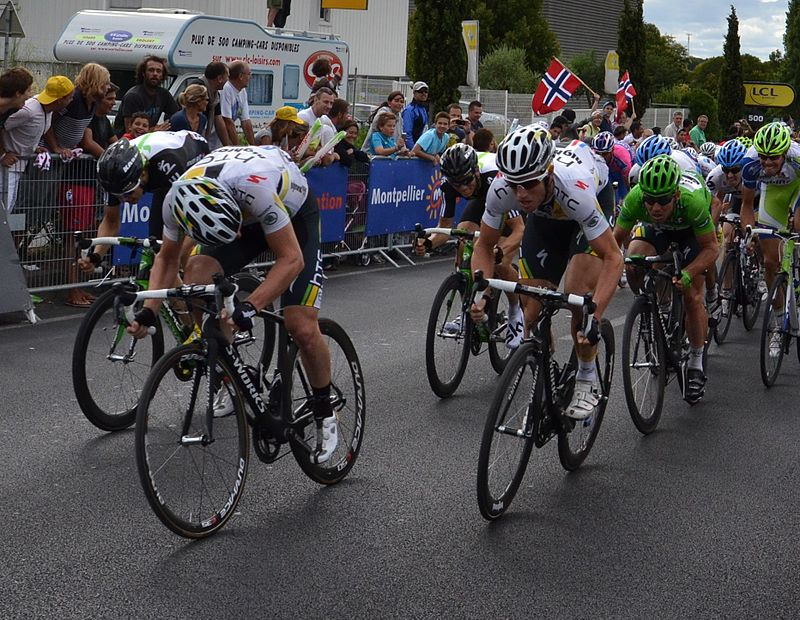 Cavendish, in the green jersey, being led out to victory by team-mates Matthew Goss and Mark Renshaw on stage fifteen of the 2011 Tour de France.