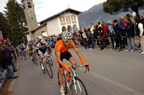 The peloton passes Madonna del Ghisallo