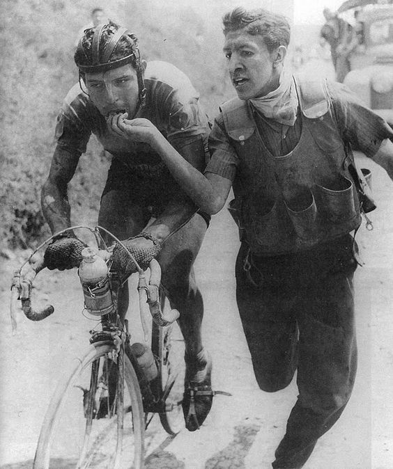 Colombian rider Ricardo Ovalle being fed bocadillo during the Vuelta a Colombia in the early 1960s