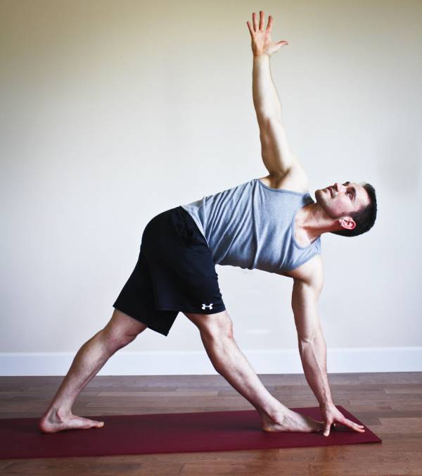 Yoga for sore backs: the reverse triangle pose photo courtesy of breakingmuscle.com