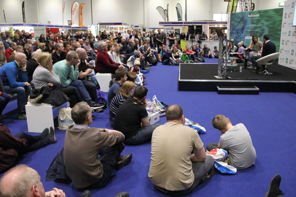 A packed crowd listening to Chris Boardman at the London Bike Show