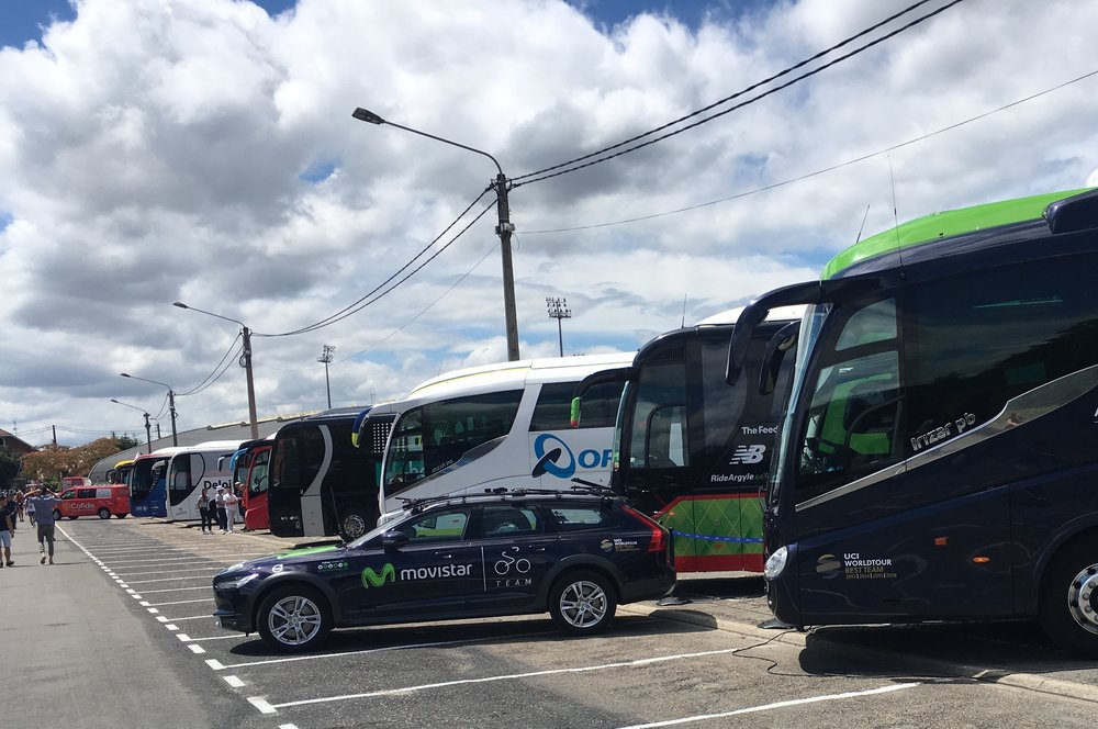 Team buses prepare for the riders' arrival