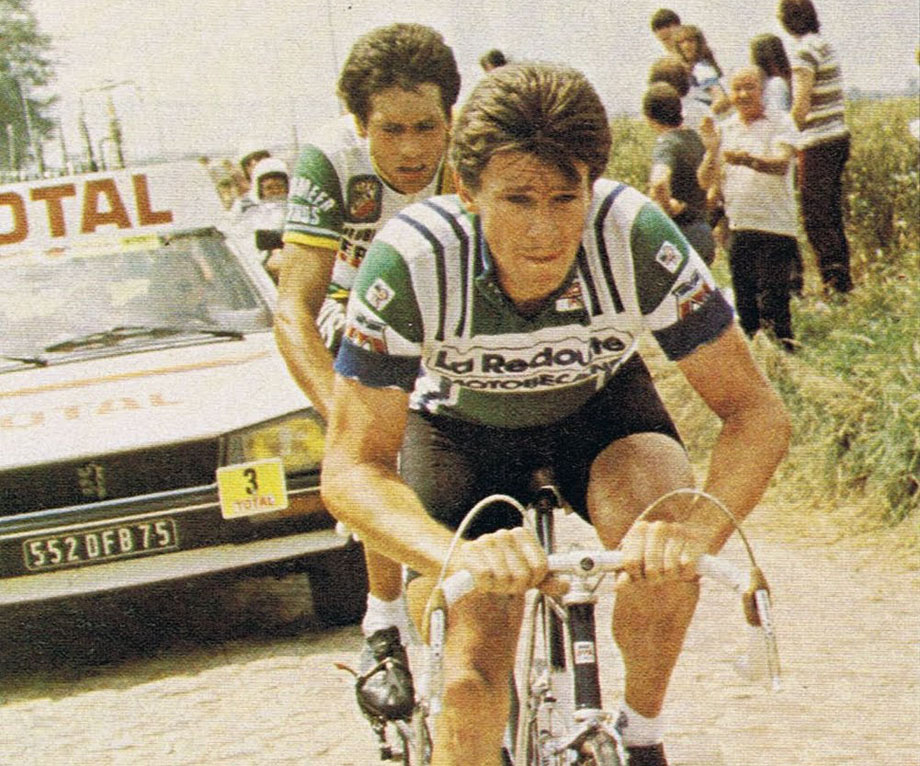 Paul Sherwen in his La Redoute kit on the cobbles