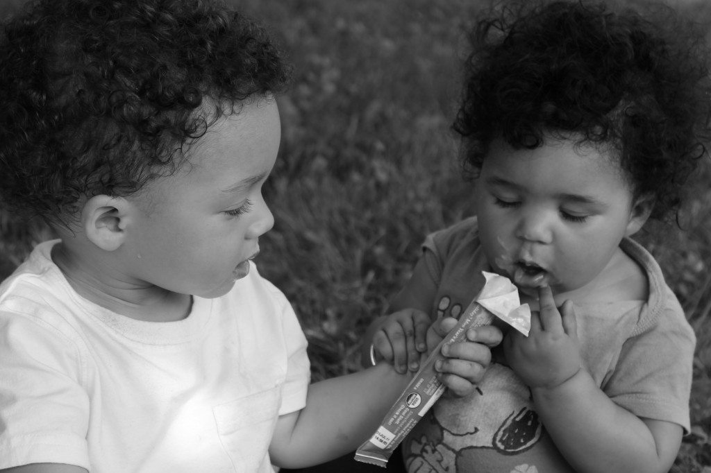 babies sharing ice cream