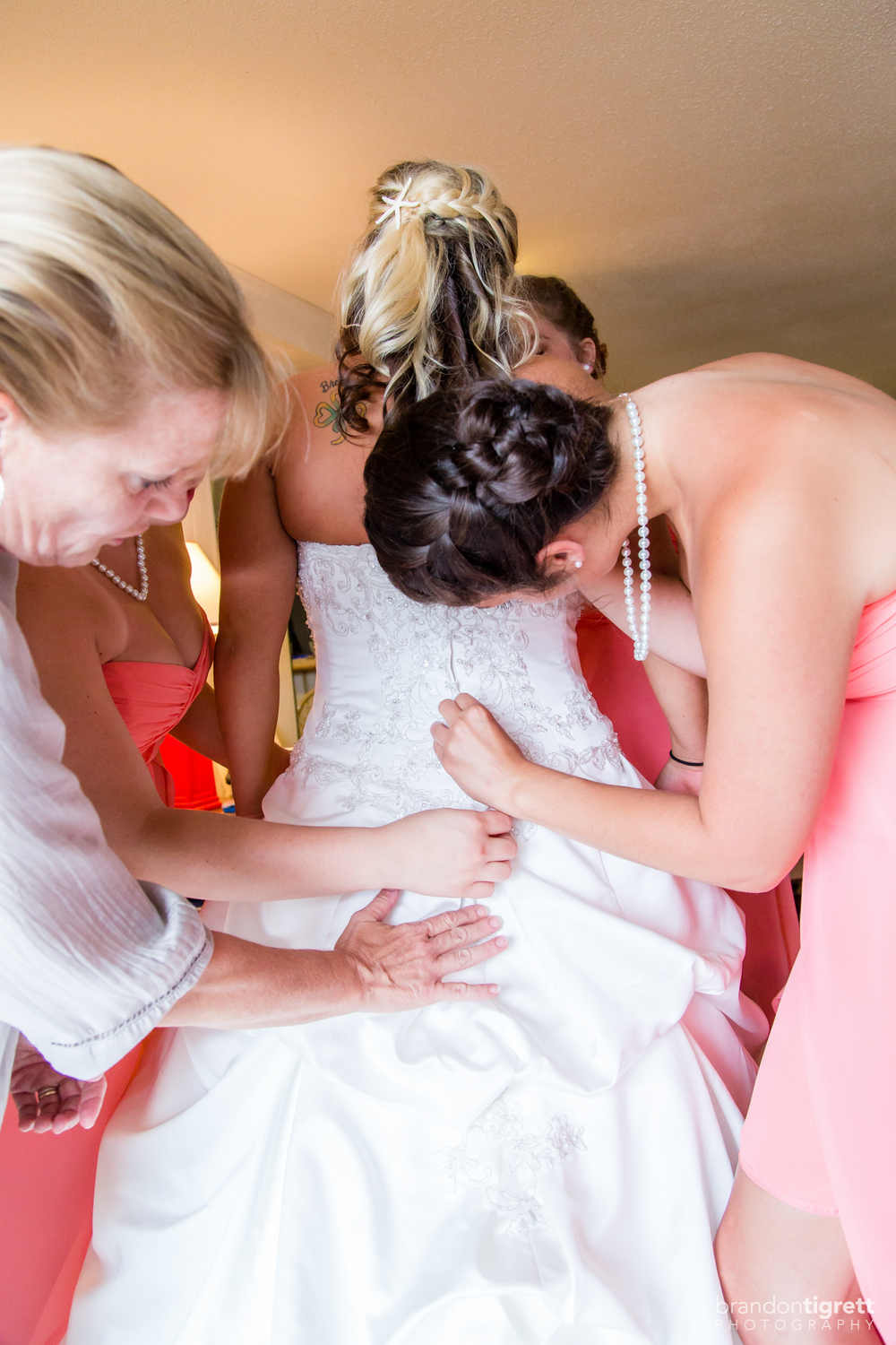 Beach Wedding Getting Ready Photos - Bridesmaids button brides gown
