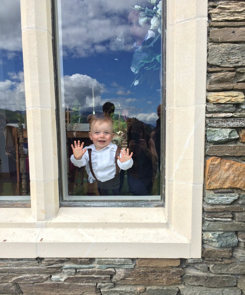 Little Austin (photo used with kind permission) loved the Chapel at Stoneridge so much that he toddled back inside to enjoy the large window!