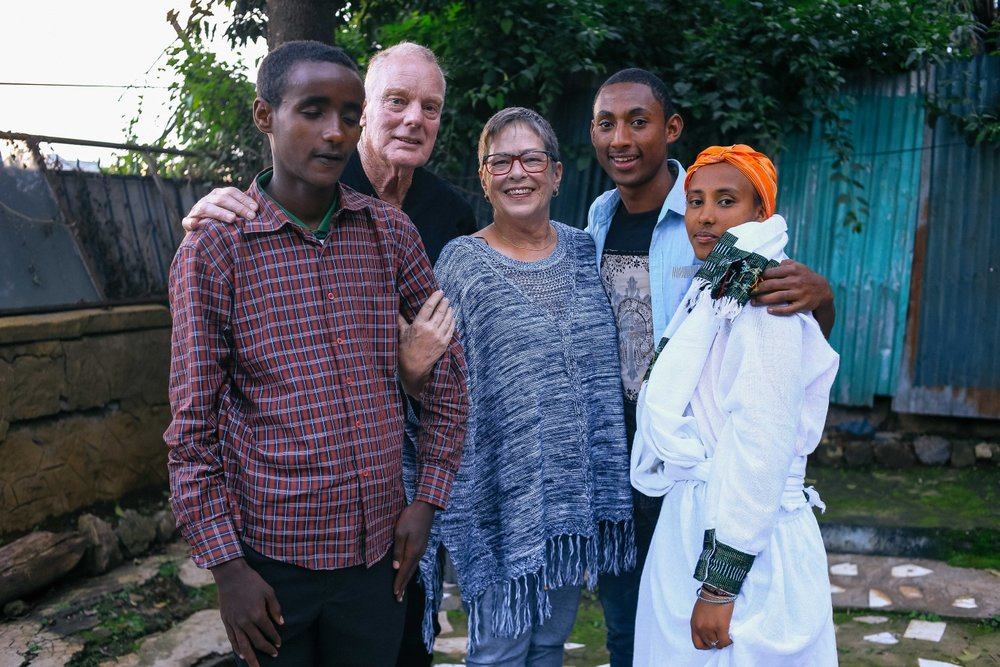 Sharon and George with Biruh, Temmar and Sebi, the three children they sponsor