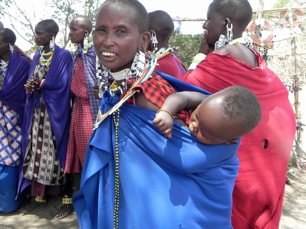 Maasai mama with her mtoto [child] in the Ngorongoro Region.