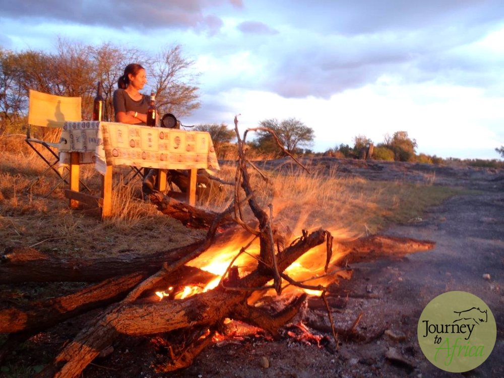 Golden Hour! Roaring fire, cold beer, stunning sunset while sitting on top of a kopje in Serengeti. Happiness.