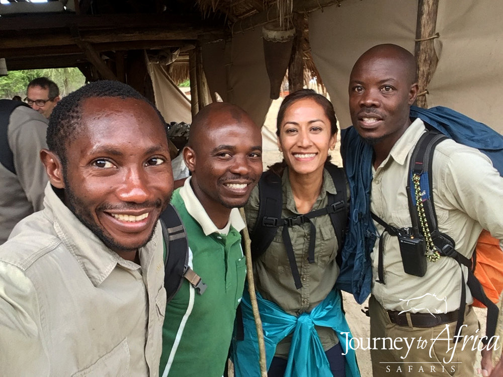 Guide extraordinaire Butati, ranger Husein, me with my huge smile, uber-guide Mathias who I am so grateful made to go on my second hike as we saw so many chimps.