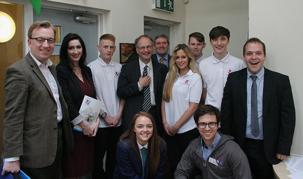 Peter Weir, Minister for Education, and David Nicholl, Dreamscheme Chairman, with group of local representatives and young people at the official opening of the new youth centre (Photo by Sarah Ellis)