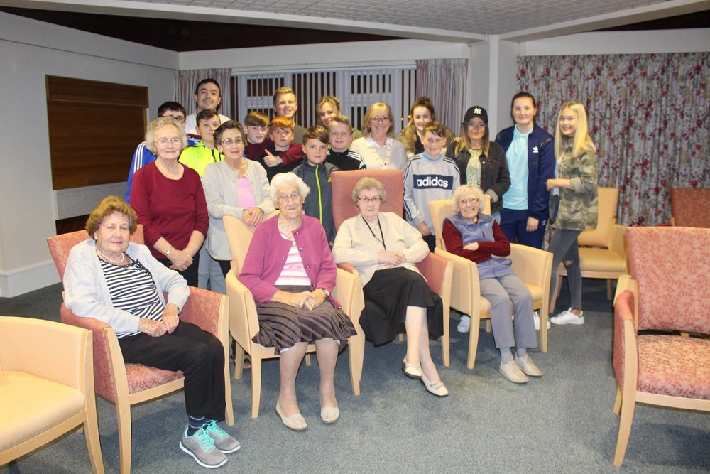 Young people with elderly residents from Taylor Court sheltered home in Belvoir