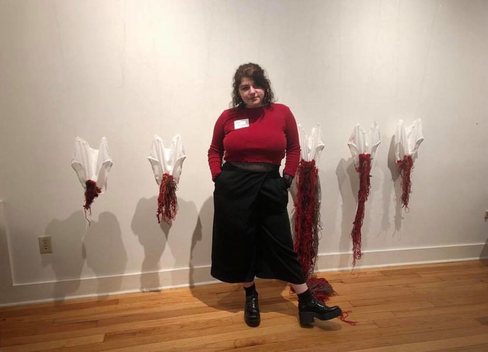 Ilie standing next to her piece  Nov. 22 - 27