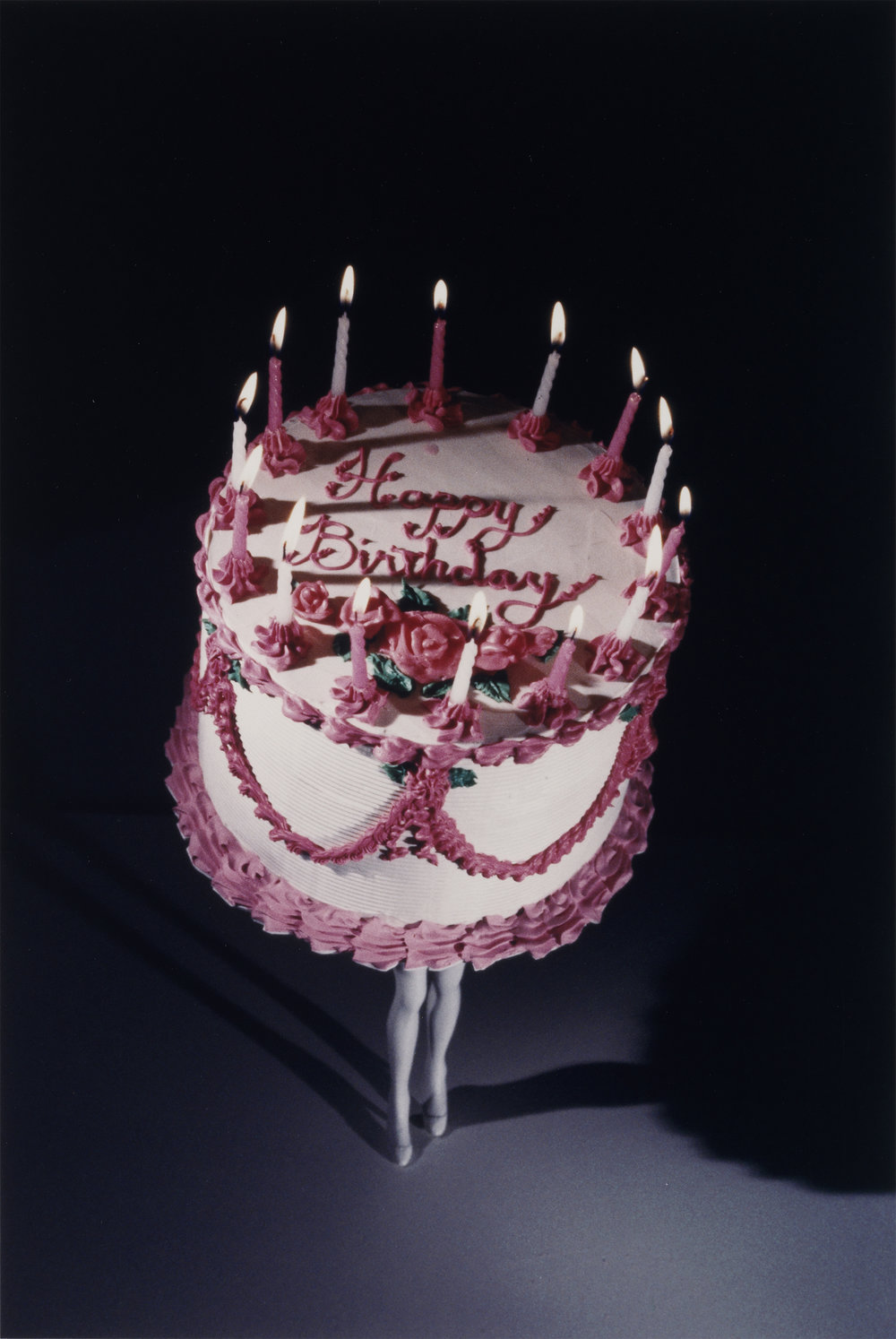 Laurie Simmons, Walking Cake II, 1989, Cibachrome print, 11 3/4 x 7 7/8 inches, Tang Teaching Museum collection, gift of Eileen and Michael Cohen, 2018.1.17
