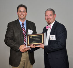 [L to R]: Nate Reck receives the Engineering Excellence Award from WVDOT Deputy State Highway Engineer Todd Rumbaugh, PE, during the ACEC of West Virginia awards banquet in Charleston, West Virginia, in October 2015.