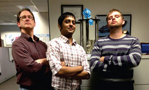 Roger Boissonnas strikes a pose with his team, Shankar Lakshmanan, a GeoDecisions developer based in Madison, Wisconsin, and Patrick Empey, a GIS planning specialist with the city of Madison, after winning the GeoDecisions 2014 Hack-a-thon with EasyAsset.