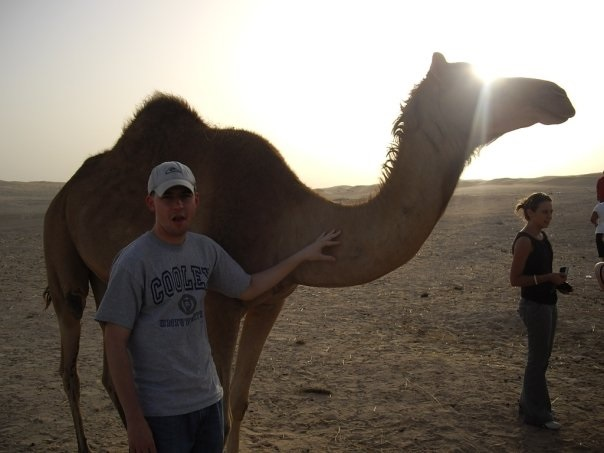 Tim petting a camel in Abu Dhabi.