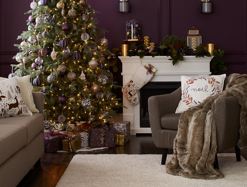 The collection includes a cushion, a stocking, a tree skirt and 3 different gift wraps
