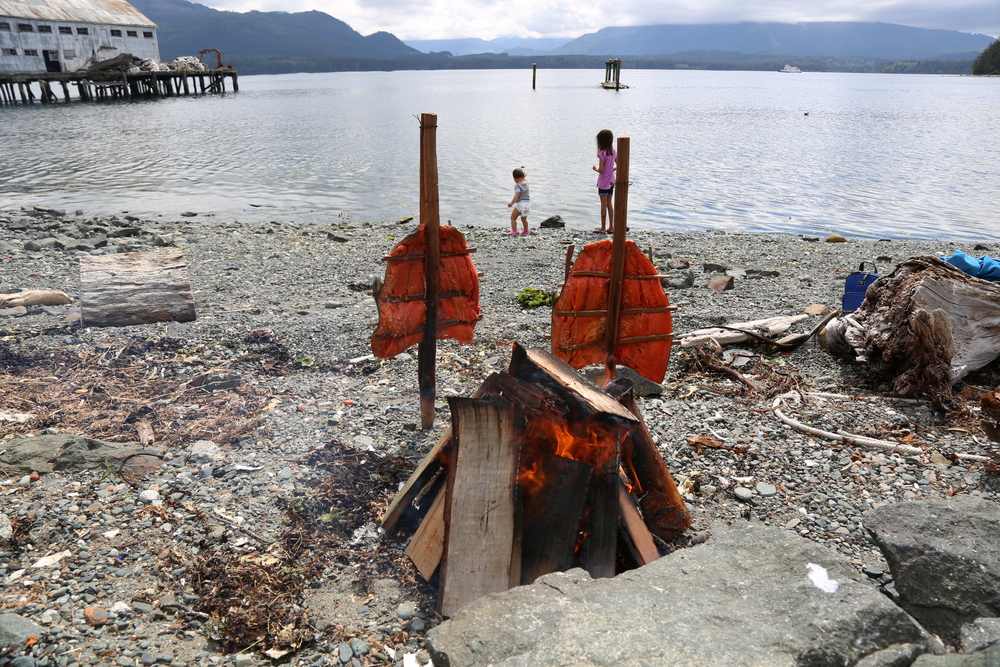 My daughter and god daughter playing on the beach of Alert Bay, BC while we prepare sockeye salmon for a family dinner.