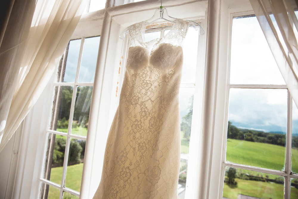 wedding dress in window overlooking gardens