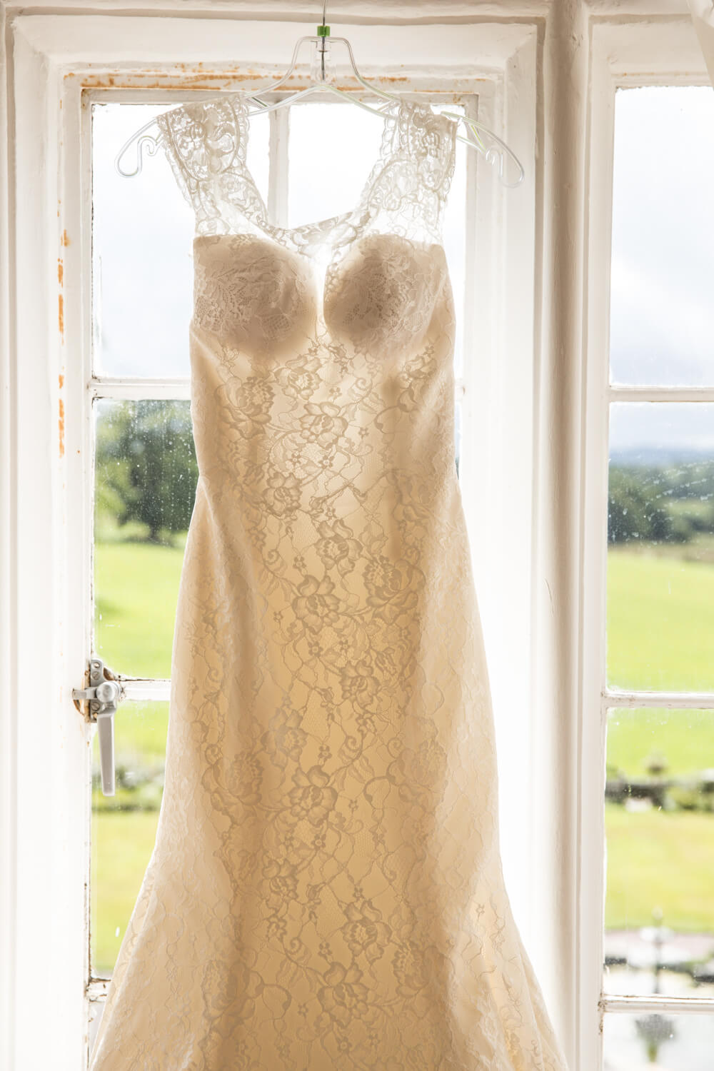 bride dress hung up in window