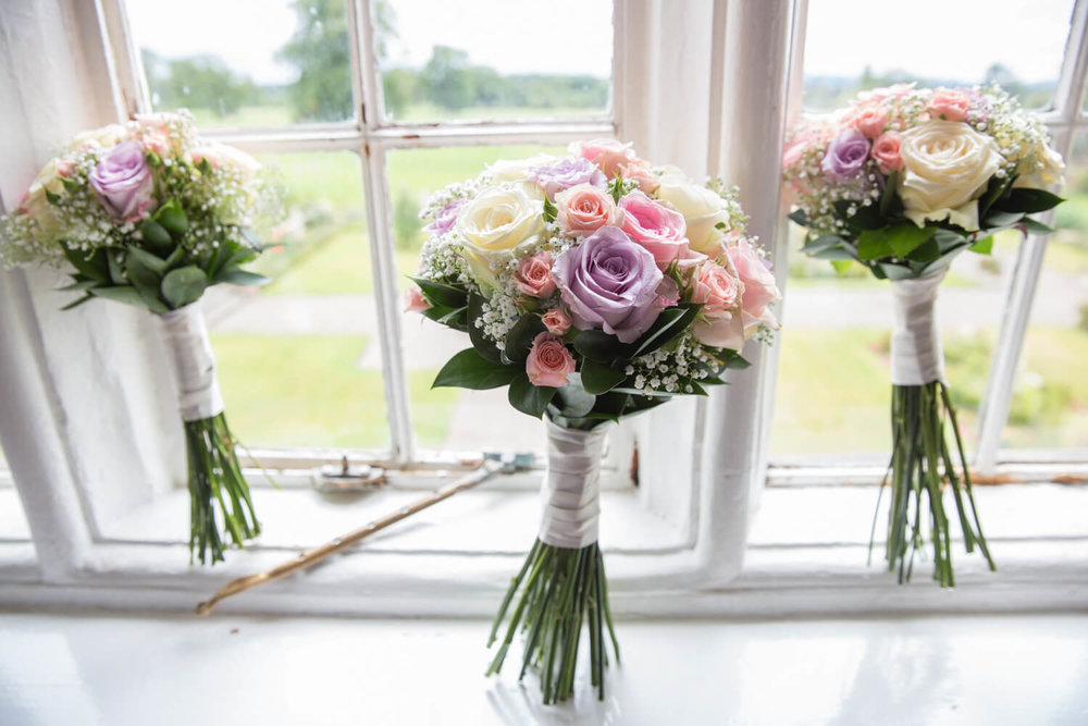 bouquets looking gorgeous by window