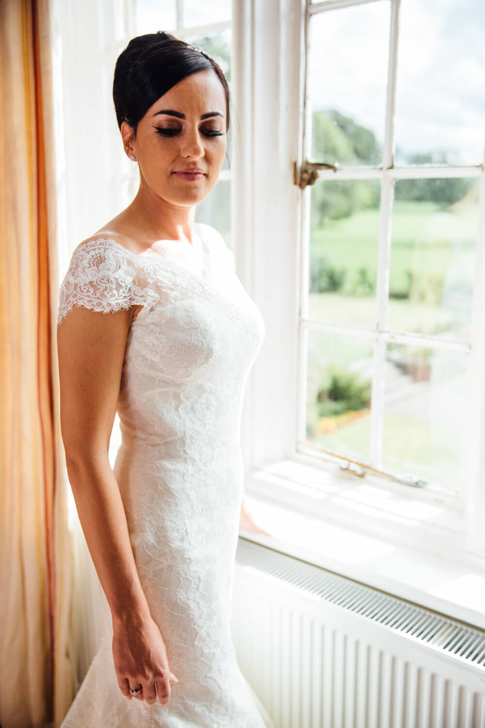 portrait photograph of bride at window